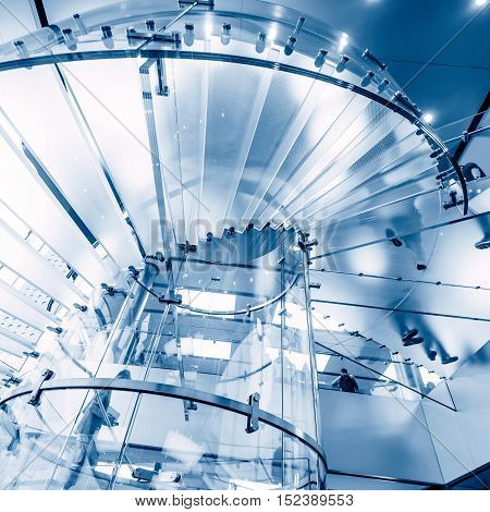 modern glass spiral staircase in shop with motion step