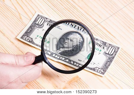Dollar bills and magnifier. Business concept and ideas