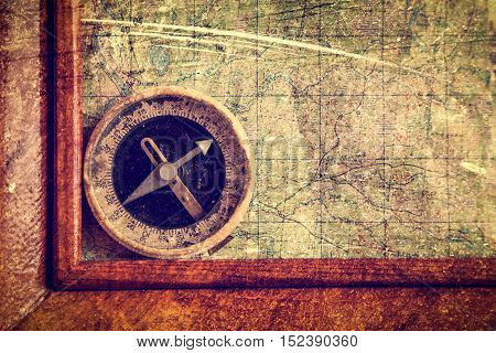 Compass and frame on the map. Photos in a grunge style.