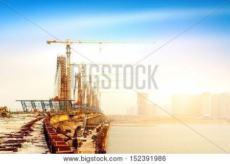 A modern concrete bridge site under construction.