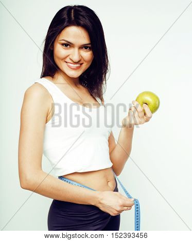 young brunette happy smiling girl measuring herself in studio isolated on white background, sport lifestyle people concept close up