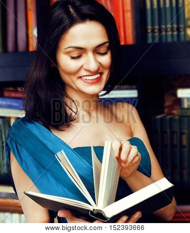 portrait of beauty young brunette woman reading book in library smiling, muslim girl in education, lifestyle people conceptclose up