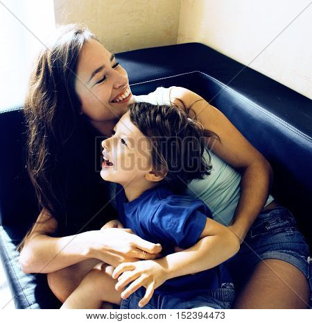 mother with son, happy family at home, smiling, lifestyle people concept close up