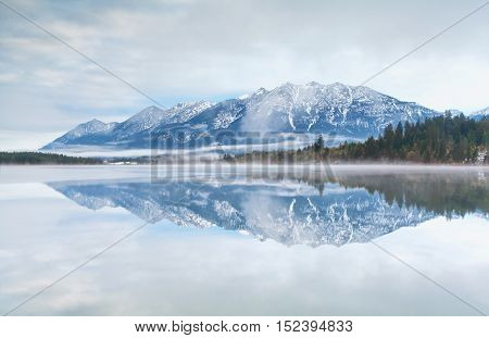 mountain range reflected in Barmsee lake Germany