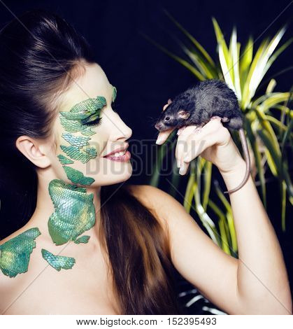 woman with creative make up like snake and rat in her hands, halloween horror closeup joke scary close up