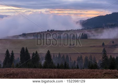 Autumn landscape. Morning fog in the mountains. Beauty in nature