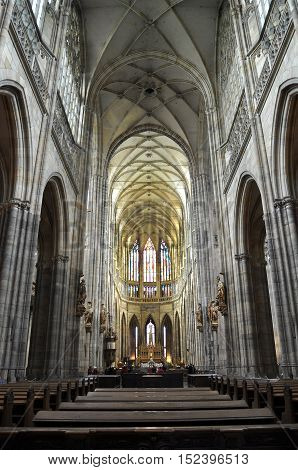 Prague, Czech Republic - April 11, 2016: Interior of the gothic cathedral of St. Vitus in Prague. Symmetric vertical perspective view.