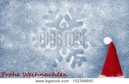 Christmas hat, snowflake, grey fiber fabric, blue glitter film and the words Frohe Weihnachten (german words for Merry Christmas)