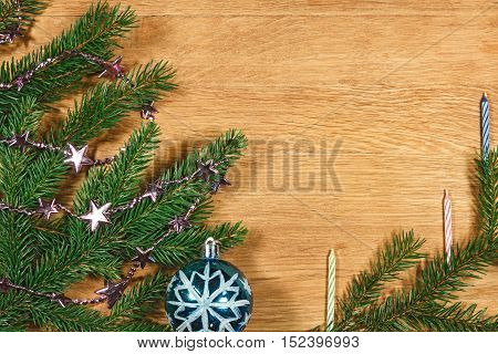 New Year 2017 Composition with fir branches bright sparkling balls and candles on the wooden background.