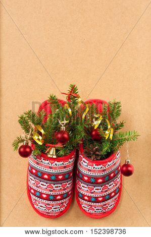 Christmas Pine Cone Decorative Balls And Fir-Tree Branches In Red Slippers With Patterns On Background. Copyspace. Christmas Tree With Decorations In Slipper.