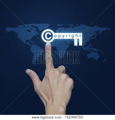 Hand pressing copyright key icon over digital world map technology style Copyright and patents concept Elements of this image furnished by NASA