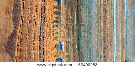 Abstract photography of landscapes of deserts of Africa from the air, yellow and blue parallel lines,
