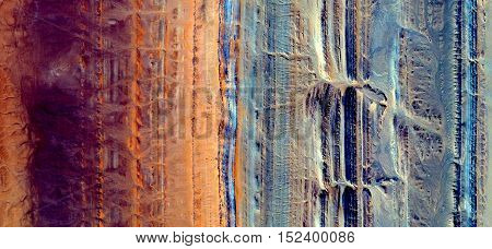 Abstract photography of landscapes of deserts of Africa from the air, yellow,red,orange and blue parallel lines,
