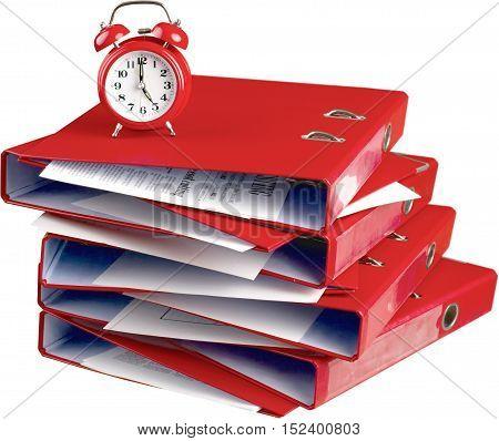 A stack of binders under an alarm clock - deadline concept