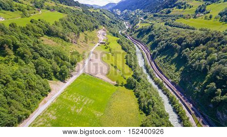 Aeria View, Salzach River Flowing Through The Valley Of The Austrian Alps