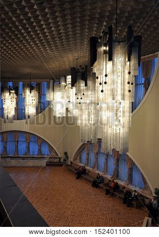 Grodno, Belarus - February 21, 2015: Interior drama theater of the 20th century in Grodno. Two storey hall with large arched windows cellular ceiling and long vertical lights.