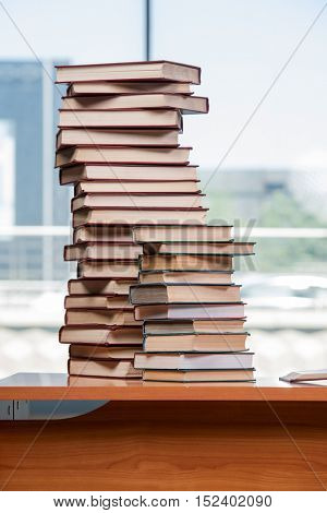 Stack of books on the desk in education concept