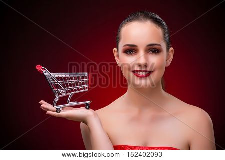 Young woman with shopping cart