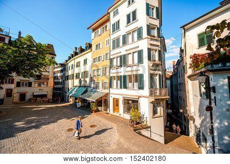 Zurich, Switzerland - June 28, 2016: View on saint Peter square with businessman walk in the morning in Zurich city in Switzerland