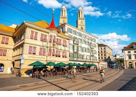 Zurich, Switzerland - June 28, 2016: Street view near Limmat river with famous Grossmunster church's towers in Zurich city in Switzerland