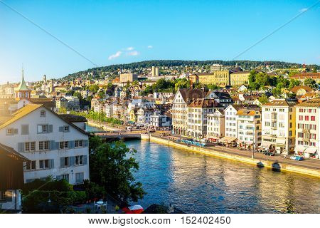 Zurich, Switzerland - June 28, 2016: Cityscape view from Linden park on the riverside with beautiful buildings in Zurich old town in Switzerland