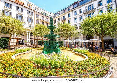 Zurich, Switzerland - June 28, 2016: Beautiful green Fountain at Zentralhof central courtyard in Zurich old town in Switzerland