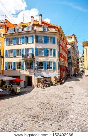 Zurich, Switzerland - June 28, 2016: Street view with cafes and colorful buildings in the old town of Zurich city in Switzerland