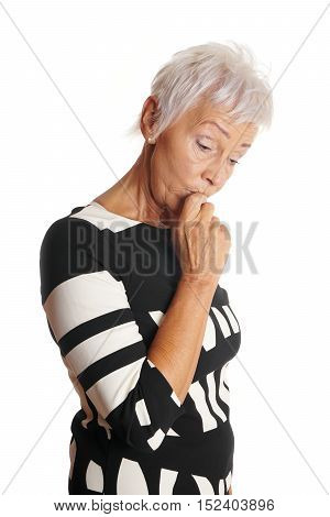 older woman looking worried and forgetful. isolated on white.