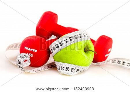 Measuring Tape Wrapped Around An Apple With Hand Weights