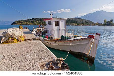 Traditional Greek fishing boat at Archaia Epidaurus harbor, Greece