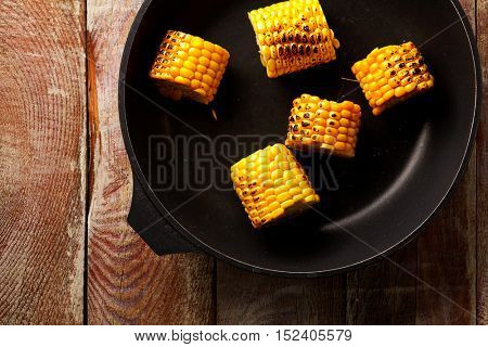 Pan Fried Corn on Rustic Wooden Table