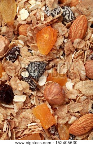 Close up on granola, dried fruit and nuts