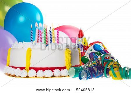 Decorative Birthday cake with candles and party favors