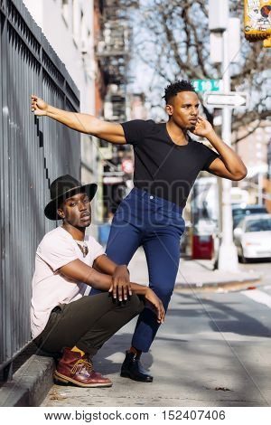 Two young men with a fashionable style posing in New York city