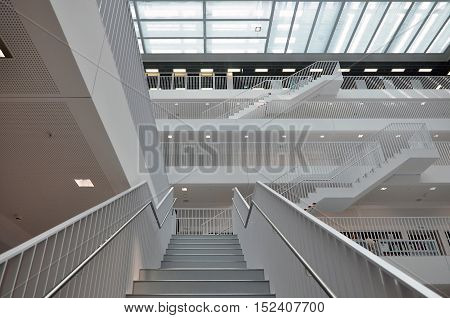STUTTGART, GERMANY - APRIL 16, 2015: White interior of a modern city library. The white staircase. Stadtbibliothek Stuttgart, Germany on April 2015.