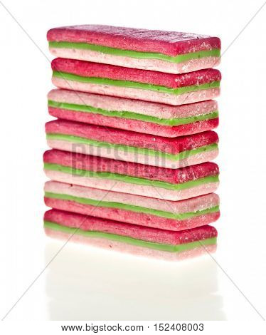 Striped colorful chewing gum, pile heap close up, isolated on a white background