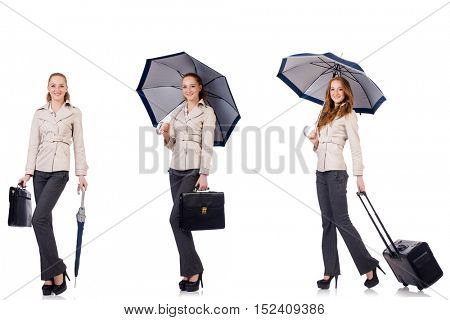 Young woman travelling with suitcase and umbrella isolated on wh