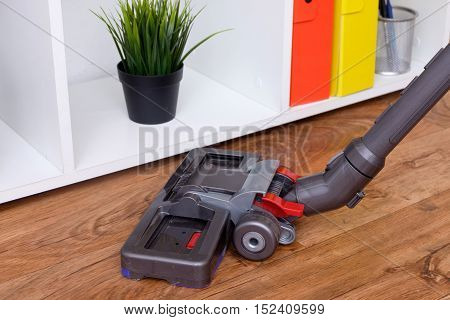 Hoovering and cleaning a new wooden parquet floor