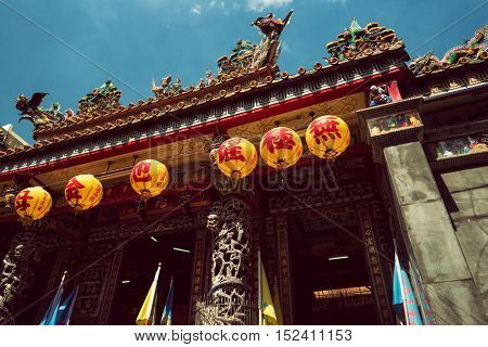 Zhongli District, Taoyuan City - October 2016: Paper lanterns and traditional colorful decoration on chinese temple.
