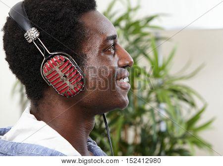 Afro-american man listening music.