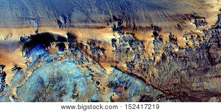 Abstract photography of landscapes of deserts of Africa from the air, magical cliffs in the desert,