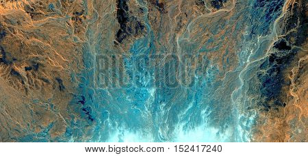 Abstract photography of landscapes of deserts of Africa from the air, fantasy blue fire, mirage of water and sand,colors yellow blue in desert