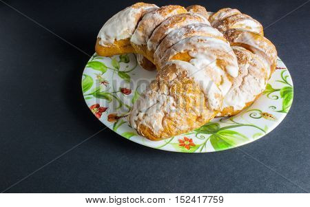 Croissants Icing In The Plate On A Dark Background