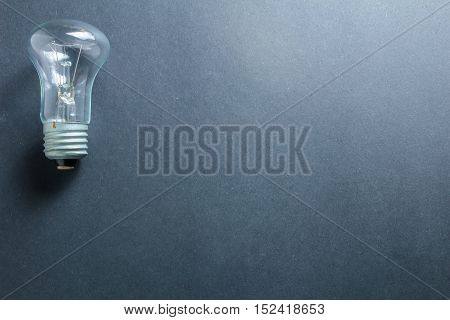 Glass Electric Light Bulb On A Dark Background