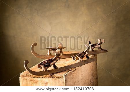 still life with old skates out of fashion