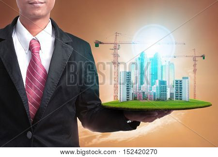 business man and high building construction project for real estate and land development business