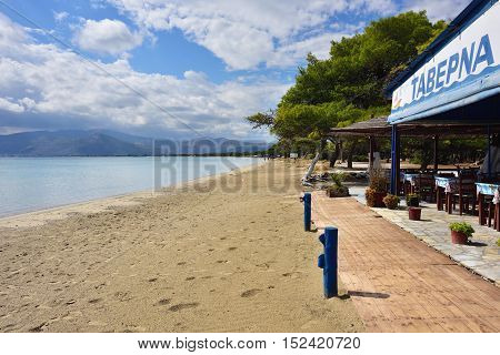Marathon Greece - Oct 01 2016: Outdoor cafe on the beautiful Schinias sandy beach one from most popular beach in Attica