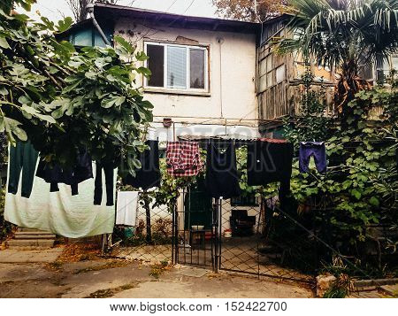 courtyard and garden two-storey house. washed clothes drying on rope