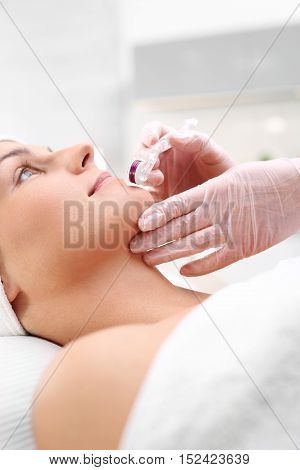 Mesotherapy microneedle, the woman at the beautician Microneedle mesotherapy, face lift