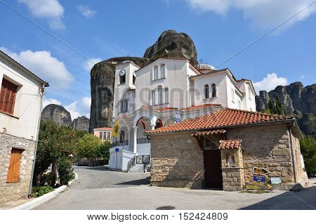 Meteora Greece - Sept 27 2016: Outdoor view on the traditional Greek white building of the Church at the center of Kastraki village surrounded with Meteora cliffs